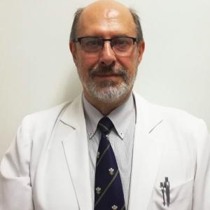 Dr. Nestor Gill Petta